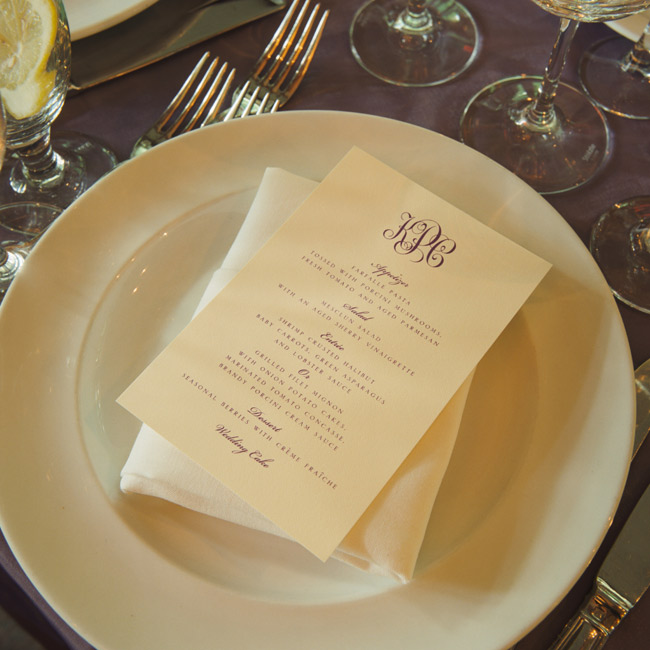 Menus were tucked inside folded napkins at each place setting. The menus were printed on ivory card stock and featured an elegant eggplant monogram.