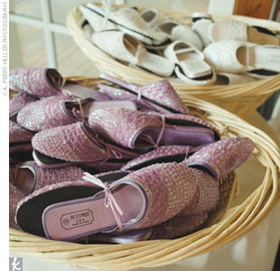 Two baskets of ivory and purple slippers greeted guests at the entrance to the reception -- good for keeping everyone out on the dance floor.