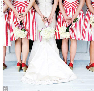 Red-and-white-striped frocks from Anthropologie and red satin wedge heels inspired the wedding day's color palette.