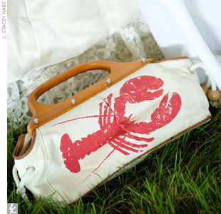 Beginning with the save-the-dates, lobsters could be found on every wedding element, from the bride's purse to the napkins and plates.