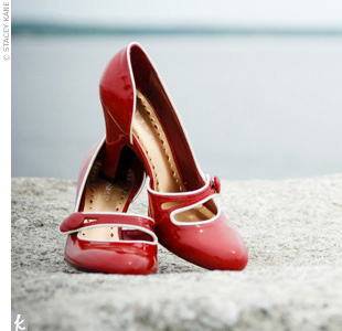 Red patent leather BCBG shoes added a kick of color to Jen's silk Duchesse satin gown by Alvina Valenta.