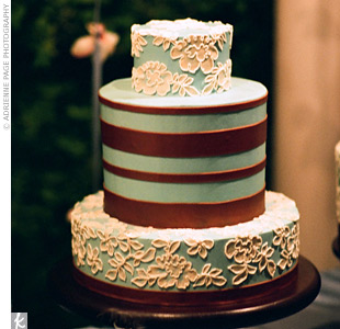 To match the light blue and copper color palette, five miniature three-tiered cakes were iced in blue buttercream. Copper stripes decorated the middle layer while a floral lace pattern, replicating the bride&#39;s dress, covered the other two layers.