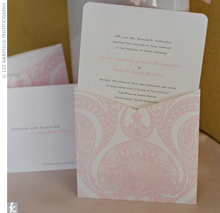 White invitations letterpressed with pink and black ink blended perfectly with the pink paisley-patterned pocket.