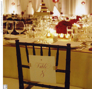 To add to the elaborate details, white and red calligraphed cards decorated with a number were tied to the back of one chair at each of the dining tables.