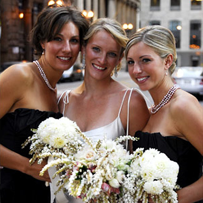 Jenni's two maids of honor wore strapless, black, tea-length dresses by BCGB Max Azria. They each received pale pink, freshwater pearl, drop earrings and a long strand of pale pink, freshwater pearl necklaces as gifts from the bride.