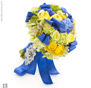 A bouquet of yellow garden roses, green and yellow ranunculus, super green roses, green viburnums, and hydrangeas wrapped with blue satin ribbon is the perfect option. Pin a vintage brooch to your bouquet for an extra dose of old-school glamour. 