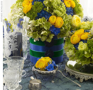 Top the tables with puffy taffeta linen, antique candelabras, salt cellars and spoons, mirrored stands, and etched glassware. For centerpieces, try yellow garden roses, hydrangeas, super green roses, blue delphiniums, ranunculus, and viburnums. 