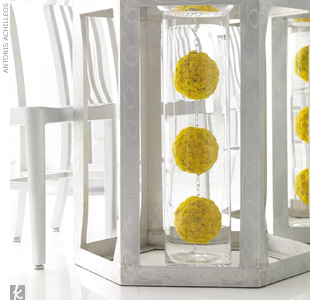 Use flowers in unexpected places. Unique extras -- like pomanders of yellow button mums hanging from chain-links inside glass cylinders that double as table legs -- add to the funky, modern motif.
