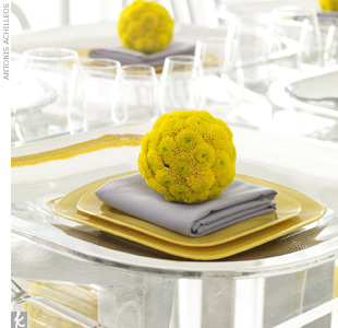 Floral spheres set atop crisp place settings are a pretty, mod extra. 