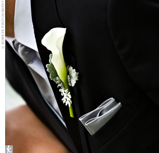 A single white calla lily with lamb's ear adorned Jason's lapel.