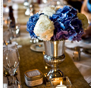 The table was decorated with candles as well as blue hydrangeas and white peonies in silver urns.