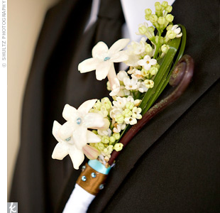 Jason's boutonniere consisted of stephanotis studded with blue stones.