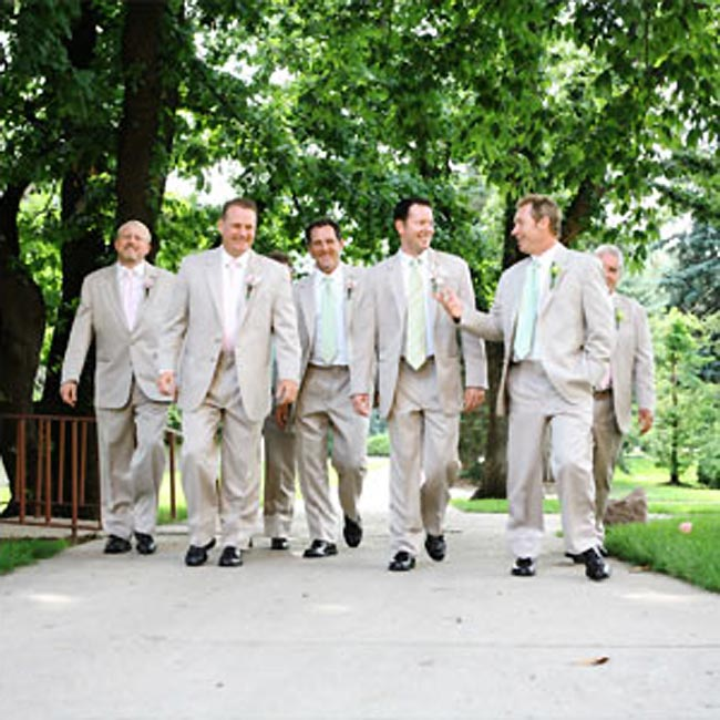 Jon and his groomsmen wore tan-colored, two-button, single-breasted tuxedos by Stephen Geoffrey. While the groomsmen donned coordinating pink or green ties to match the bridesmaid dresses, the groom wore a pink and green–striped tie to unite the look.