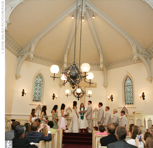 Since the church where their ceremony was held was small and charming on its own, the couple opted for only lighted candles at the altar.