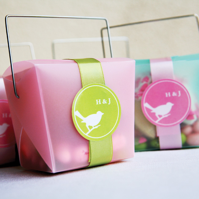 Hai and Jon's guests took home frosted pink or green take-out boxes filled with color-coordinated Jelly Belly beans and a wrapped fortune cookie dipped in white or green chocolate with red or pink sprinkles. The boxes were decorated with personalized bird labels and ribbon.