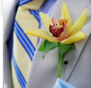 A single yellow orchid pinned to a khaki suit with a yellow and navy tie made Matt's groomsmen true crowd-pleasers.
