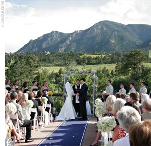 The ceremony was held outside on a large deck facing west towards a gorgeous mountainous backdrop. They married under an altar decorated with large, light green and white hydrangeas.
