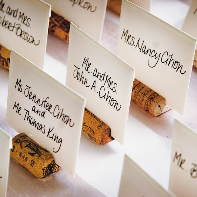 "Matt and Kate shared their love of wine with guests by displaying their escort cards in corks. ""My maid of honor personally wrote each card because she has such nice handwriting,"" explains Kate."
