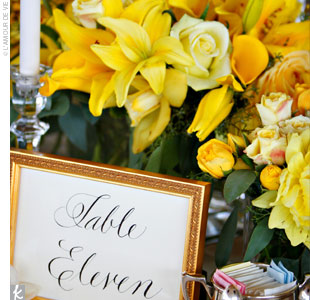 "The reception tables were accented with yellow floral centerpieces and two tall candlesticks with beaded lampshades on top. ""At other weddings I've attended the bouquets are so tall you can't see anyone across the table,"" says Kate. ""These added height to the tables without obstructing the view of our guests."""