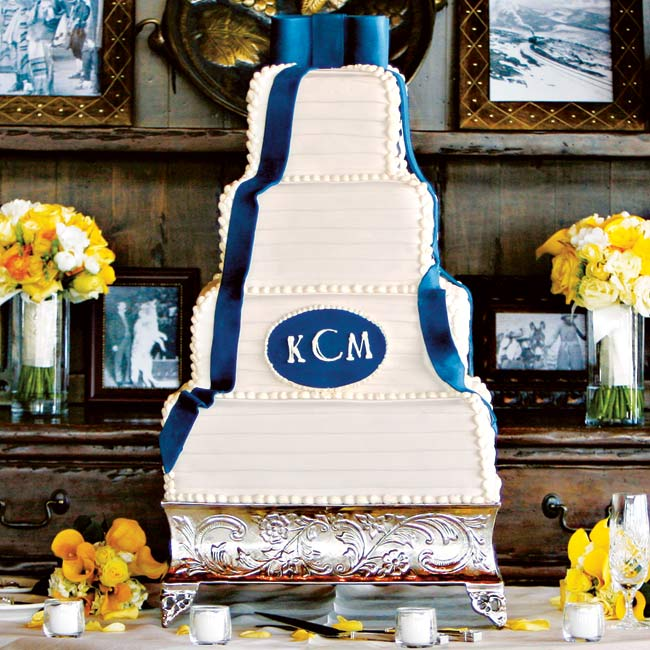 The simple, four-tiered cake was covered in white fondant and decorated with the couple's monogram and a navy blue fondant ribbon.