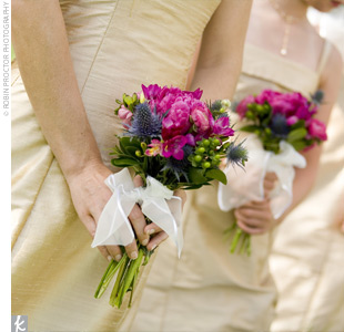 The bridesmaids carried colorful green and raspberry bouquets accented with white ribbon.