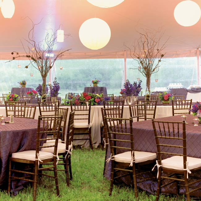 The reception tent was adorned with 80 white paper lanterns and lights that morphed slowly from raspberry to blue to green.