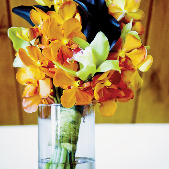 Melissa carried a striking combination of orange and lime green orchids along with deep purple calla lilies.