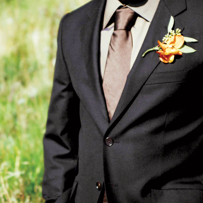 Jesse wore a sharp black suit from Paul Smith in New York City and highlighted the look with a chocolate brown tie and deep orange boutonniere.