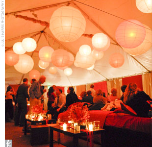 """We strove to bring an L.A. or NYC lounge atmosphere and coolness to the mountains,"" says Jesse. Giant white paper lanterns, papered walls, and plush lounge beds helped to create the chic experience the couple wanted their guests to enjoy."