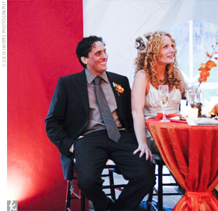 "Melissa and Jesse decided to have an ""East meets West"" theme for their fall wedding because their guest list was bicoastal and their wedding site was on the Continental Divide. Pumpkin orange, cherry red, and chocolate brown highlights helped to make their fall-inspired color palette complete."