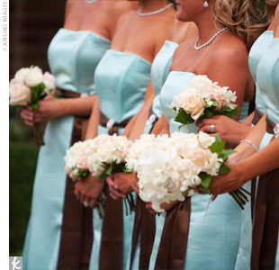 Kasey&#39;s bridesmaids carried bouquets filled with white dendrobium orchids and blush pink and cream Anna and Vendela roses tied with brown satin and decorated with studded pearls.