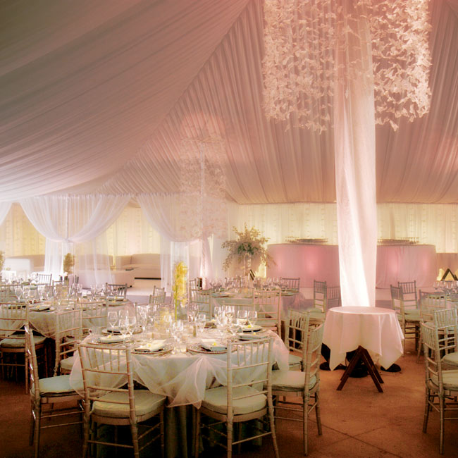Nine garland lampshades featured hundreds of butterflies suspended from the tent's ceiling. Pinspot lighting created a dramatic effect. On the back wall of the lounge area, 60 strings of white butterflies were attached to the white drapery.