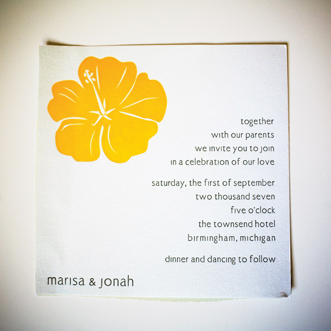 Marisa and Jonah chose a white invite with a bright yellow letterpress-printed hibiscus to set the tone for a laid-back and fun atmosphere for their wedding.