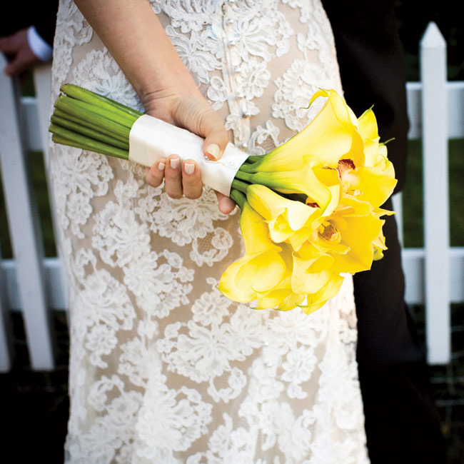 Marisa's hand-tied bouquet was filled with yellow mini calla lilies and cymbidium orchids.