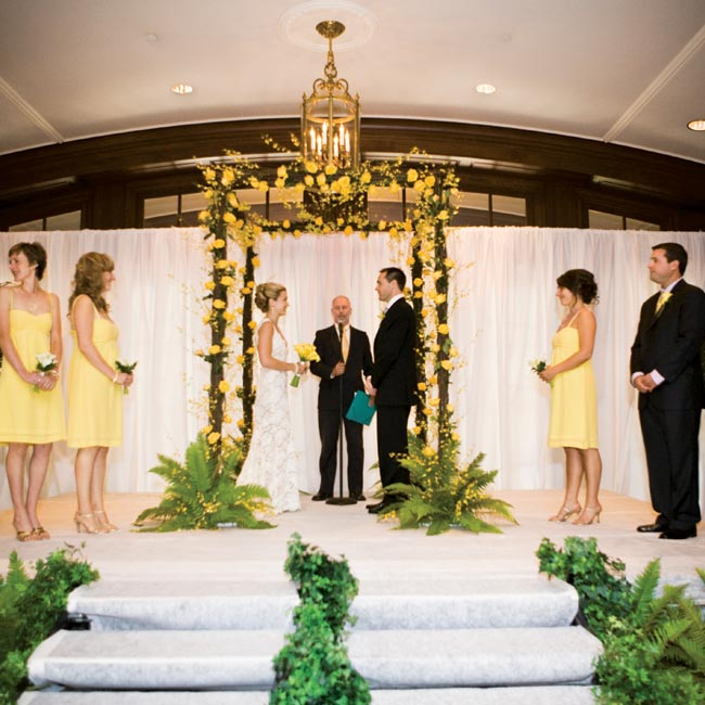 The couple married beneath a huppah made of vines and decorated with bright yellow flowers in the hotel's grand foyer. An ordained family friend performed the ceremony, in which Marisa and Jonah exchanged handwritten vows.