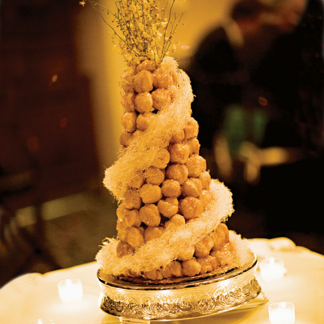 "In lieu of a traditional tiered confection, the couple served a French croquembouche topped with sprays of yellow orchids. ""People could not stop raving about the cake,"" says Marisa."