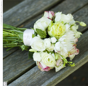 Aruna carried a hand-tied bouquet of white orchids, pink and maroon ranunculuses, white stars of Bethlehem, and roses.