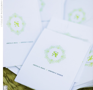 White programs with the couple's monogram embossed in a green henna print introduced guests to the wedding party and chronicled the history of the arboretum where the ceremony took place.