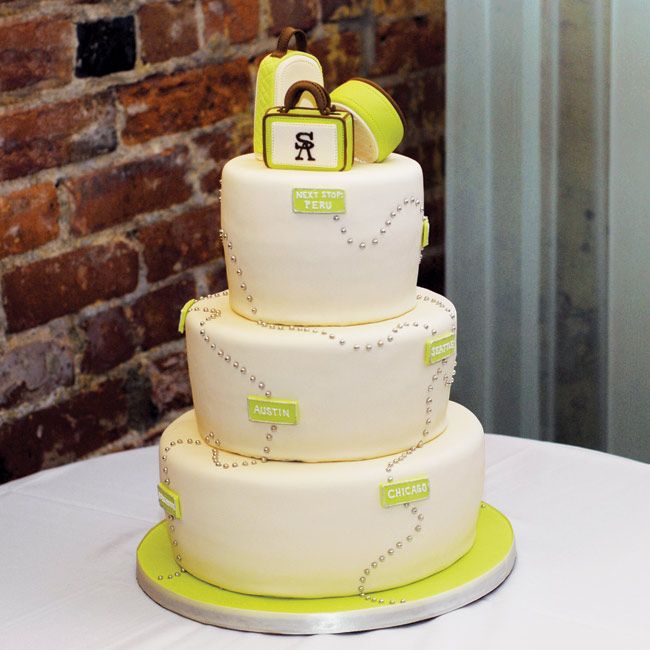 "In honor of their honeymoon, the couple designed a white cake with a green dotted line motif topped with vintage luggage and a sign that said, ""Next Stop: Peru."" The three-layer confection was filled with vanilla and chocolate cake with fresh raspberries."