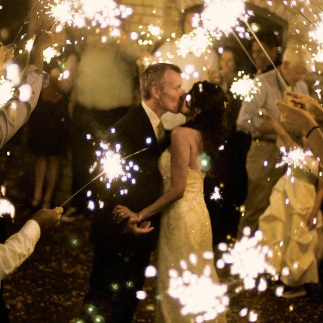 "Guests lit sparklers for the couple's send-off. ""We decided not to have a real, official exit because we didn't want people to feel like they had to leave -- it was wonderful,"" says Aruna."