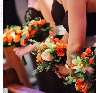 Haley's nine bridesmaids carried vibrant bouquets of orange, yellow, and pink roses and lilies. The colors stood out against the chocolate brown dresses wrapped in celadon green sashes.