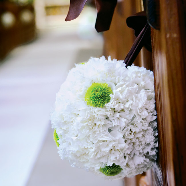 Haley and Craig used small touches to add to the old stone chapel's already exquisite decor. Small pomanders of white and green flowers tied with chocolate ribbon hung from the pews.