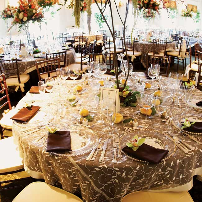 Round tables were covered in chocolate brown linens featuring ivory organza in a leaf pattern. Chiavari chairs in chocolate brown with ivory seat cushions matched perfectly.