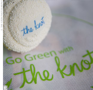 "Guests took home simple and sweet cupcakes topped with The Knot insignia, along with canvas totes sporting the ""Go Green"" message."