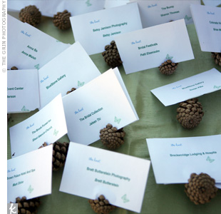 Clean white card stock and touches of nature will give your green escort card display a fresh look.