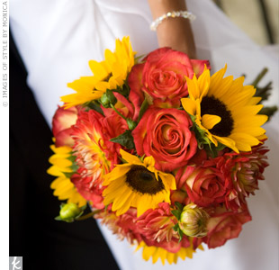 Valerie carried a bold bouquet of orange dahlias, orange sunflowers and sunset-colored roses.