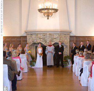 The couple exchanged vows in front of a beautiful fireplace at The Detroit Yacht Club.