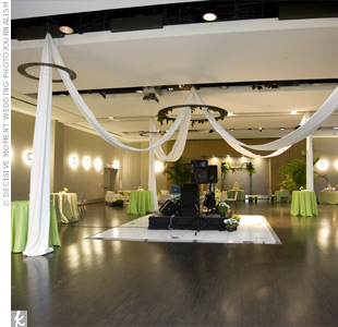 Yards of white fabric flowed from the center of the dance floor and out to the four corners of the space.