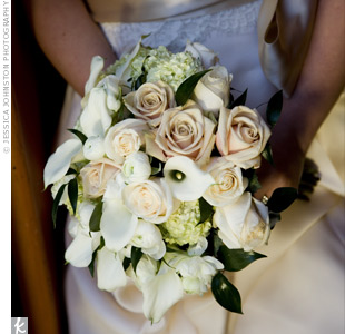 Andrea carried a full bouquet of Sahara and ivory roses, mini calla lilies, green viburnum and white ranunculus.