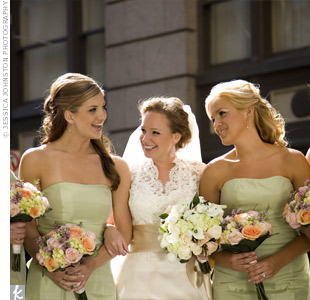 Strapless, knee-length celery green dresses complemented the white and pink bouquets.